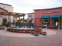 The new development, Centennial Plaza, and the colorful fountain.