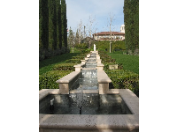 Cypress trees and terraced fountain in the Italian garden.