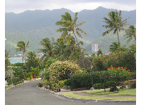 Hanapepe Loop and the tall, jagged mountains that rise above the suburb of Hawaii Kai.