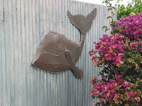 Whale decoration on a gate at Hanapepe Place.