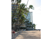 Hau Tree Beach, the wall in front of it where people hang out, and the classy high rises behind.