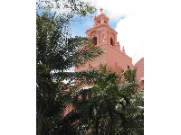 The mission-style bell tower. Pink was in vogue in the 1920s.