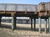 The wooden promenade and the pier behind.