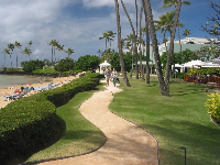 Winding walkway to the wedding gazebo. There are lovely lawns with hammocks at Kahala Resort.