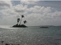 Outrigger canoe by the island, as seen from Waialae Beach Park.