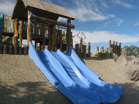 The blue slides that hug the hill, and the powdery blue Paso Robles sky behind.