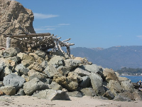 A lookout made of logs, where surfers sit to watch the action.