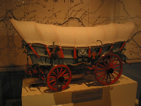 Model of a covered wagon, on the Heroes exhibit.