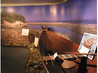 Exhibit of a wooden tomol, a Chumash canoe built to make the rough journey to the Channel Islands.