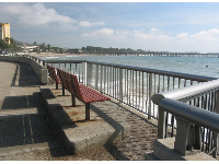 A place to sit along the promenade and watch the surfers catch waves. See the pier in the distance.