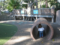"Tunnel at the zoo play area. See the ""treehouse"" in the background, where parties are held."