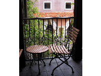 Balcony overlooking the courtyard at Hotel Valencia.