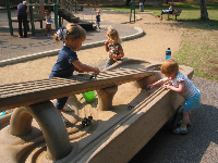 Toddlers playing at Tucker's Grove.