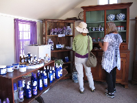 Ladies choosing some lavendar lotion.