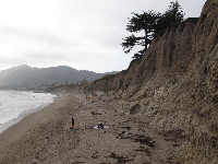 The cliffs that shelter the beach.