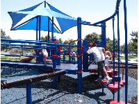 Playground in southeast corner, with blue shade canopy.