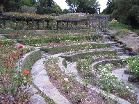 The wonderful terraces. A young couple enjoys the garden (bottom left).