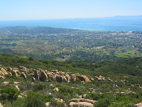 Scattered boulders and birdseye view of Santa Barbara at Playgrounds.