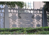 Ornamental metal fence with inspirational transcription along 5th Street beside the Central Library.