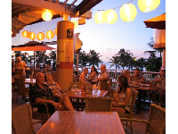The lanterns and ocean beyond at Tiki's Grill and Bar.