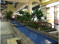 The blue step-like fountain on the second level.