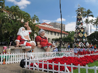 Christmas in Hawaii at Honolulu Hale- the famous Santa and his wife!
