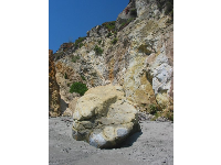 Yellow cliff face and boulder, the east side of the beach.