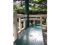 Lay on this lovely cool blue-green bench in the Japanese gazebo.
