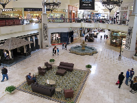 Couches and Spanish fountain on the first level.