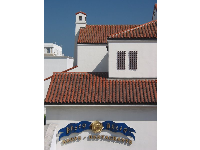 I love Spanish red-tiled roofs!