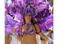 Samba dancer in purple feathered head dress in the 2011 Summer Solstice parade. Photo be Arturo G. Vega.