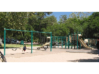 The swings, sand pit, and playground with slides. It's nice that there's some shade near the playground.
