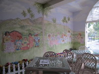 Tea room with mural of teddy bear picnic with Santa Ynez mountains behind.
