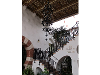 El Andaluz's ironwork stairrail and chandelier.