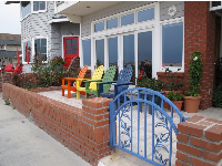 Beachhouse with colorful adirondack chairs.