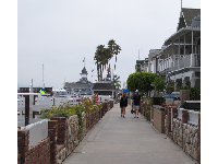 Walking along by the houses on the harbor side.