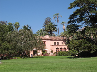 The Spanish house stands by a huge lawn.