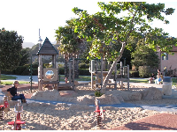Play structure and bouncies, over lovely clean sand.