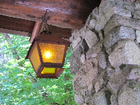 Lamplight and stone decor, at the entrance to the hotel.