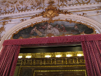 Painting above doorway.