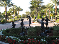 Statues of children balancing.