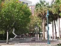 Trees, public art, and historical buildings at Heritage Square.