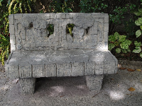 A carved stone bench in the Tropics of the Americas section.
