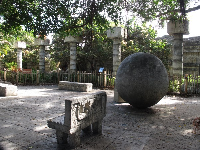 Columns, ball, and stone bench in the Tropics of the Americas section.