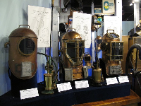 Miller-Dunn diving masks and air pumps from the early 20th century.