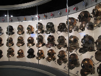 Wall of diving helmets from around the world.