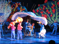 Giant sting ray and coral held up by actors in the Finding Nemo musical.