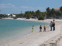 Kids enjoying the white sand beach on the Indian River Lagoon.