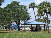 Playground, shade gazebos, and trees outside the aquarium.