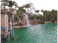 Venetian-style lamp posts and rock cave with waterfall.